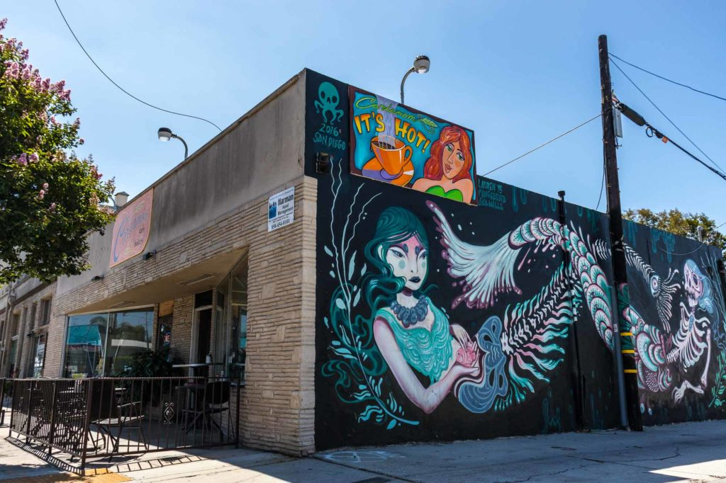 Cardamom Cafe's in North Park. The corner of the bakery showing the large mural of skeleton mermaids.