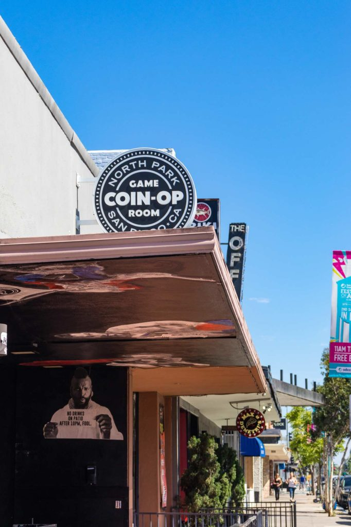 Coin Op in North Park, San Diego's sign hanging above the front outdoor space of the arcade bar.