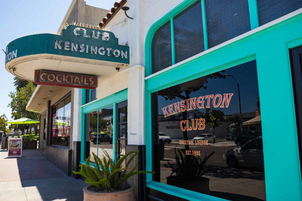 A blue and white Club Kensington building near Adams Avenue in Kensington San Diego.